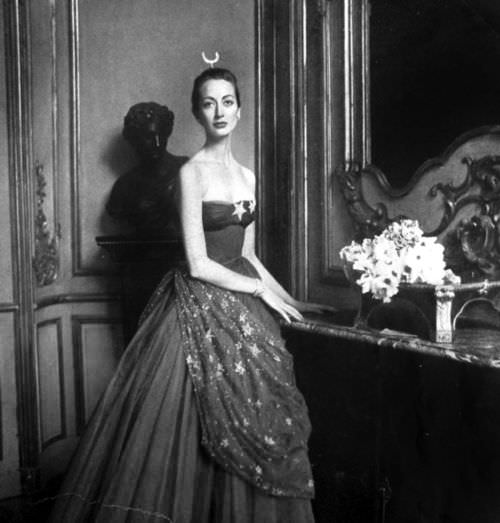 Model wearing a gown by Pierre Balmain for Vogue Paris, 1951